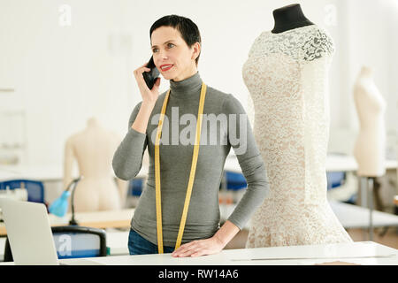 Consulting client on the phone - Stock Image
