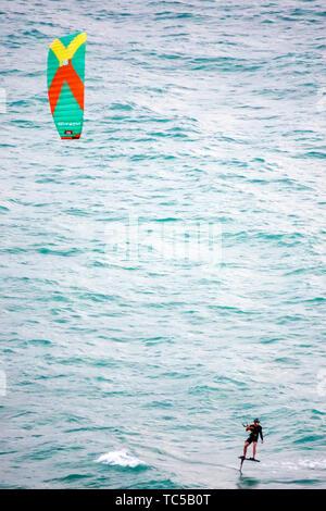 Miami Beach Florida Atlantic Ocean kiteboarding kiteboarder kitesurfing kitesurfer watersports man waves water - Stock Image