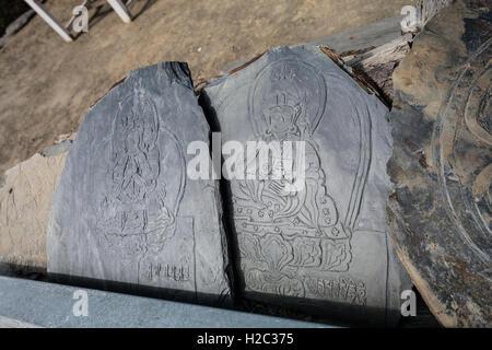 Closeup Photo Autentic Draw Stone Budda Symbols and Mantras. Horizontal. Nepal Travel Trakking - Stock Image