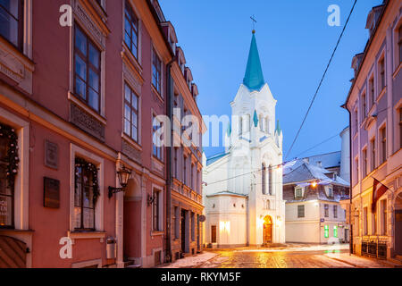 Winter dawn at Our Lady of Sorrows church in Riga old town. - Stock Image