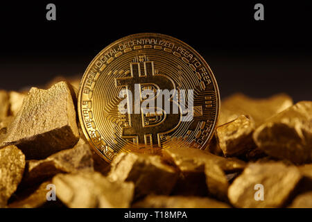 Golden Bitcoin Coin and mound of gold. Bitcoin cryptocurrency. Business concept. - Stock Image