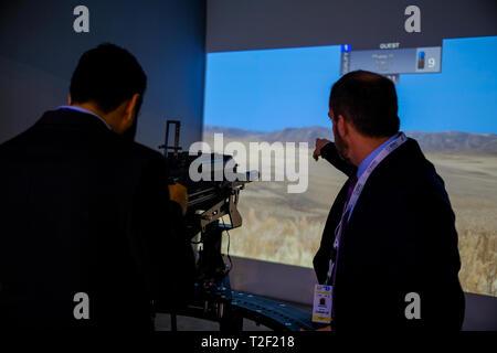 February 18, 2019 - Abu Dhabi, UAE: Instructor of Gun simulator display pointing at aim - Stock Image