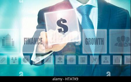 Businessman pressing an $ concept button. - Stock Image