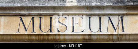 Sign saying 'Museum' in a sandstone wall above the entrance to the Winchester City Museum. Winchester, Hampshire, - Stock Image