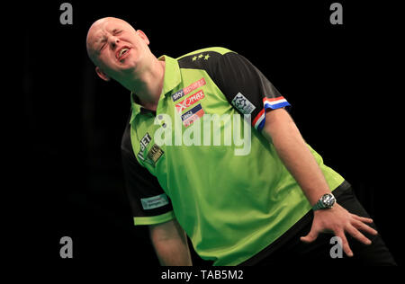Michael Van Gerwen reacts in his semi-final against Daryl Gurney during the Premier League Play-Offs at The O2, London. - Stock Image
