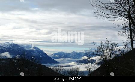 View Of Snowcapped Mountain Against Cloudy Sky - Stock Image