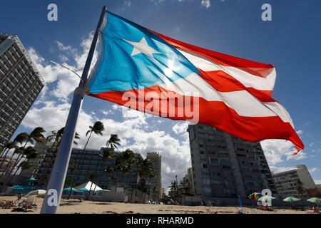 A Puerto Rican flag flying on the beach in Condado, San Juan, Puerto Rico - Stock Image