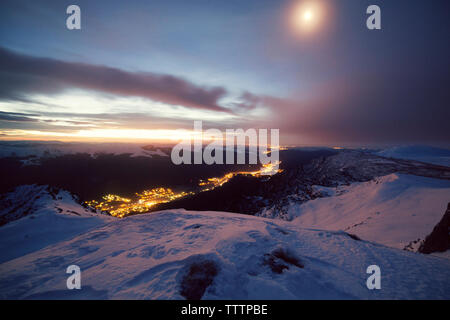 Scenic view of valley amidst snowcapped mountain against sky - Stock Image