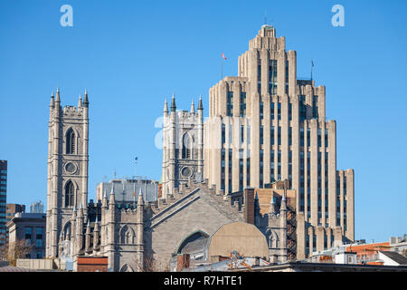 Skyline of the Old Montreal, with the Notre Dame Basilica in front, and a vintage stone Skyscraper in the background. The basilica is the main cathedr - Stock Image