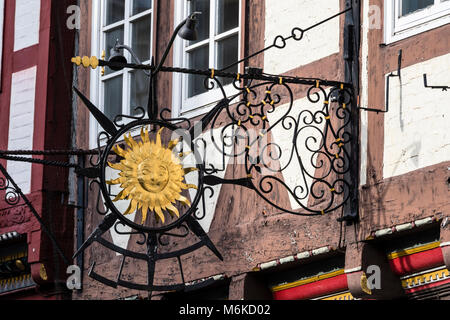 metal shop sign, historical center of Celle, half-timbered house in street 'Schuhstrasse', Celle, Lower - Stock Image
