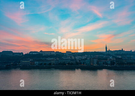 Sunset view of the Matthias Church and River Danube bank at Budapest, Hungary - Stock Image