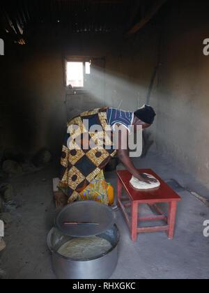TANZANIA  -  photo by Sean Sprague 2018  Woman making bread, Bukundi. - Stock Image