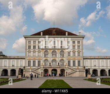 Munich, Bavaria, Germany - May 23, 2019.  Tourists outisde of the Nymphenburg  Palace on a beautiful sunny spring day with blue skies and a few clouds - Stock Image