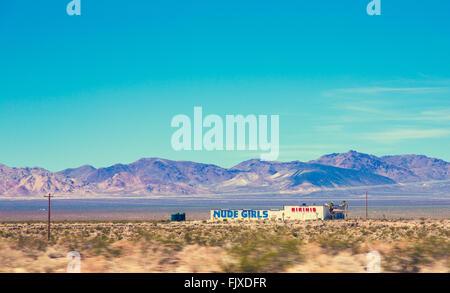 Nevada Desert, Nude Girls advert - Stock Image