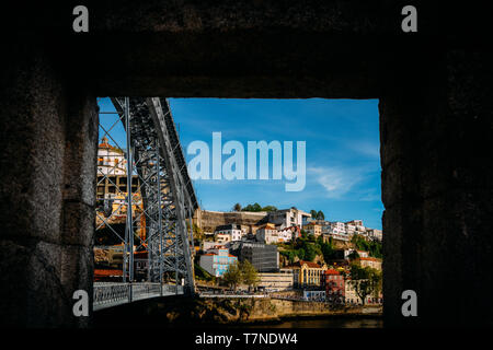 Frame of Dom Luis I bridge in Cais Ribeira, Porto, Portugal on the Douro River. Not a painting - Stock Image