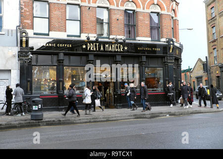 Exterior street view of pedestrians outside Pret a Manger Shoreditch East London E2 England UK KATHY DEWITT - Stock Image
