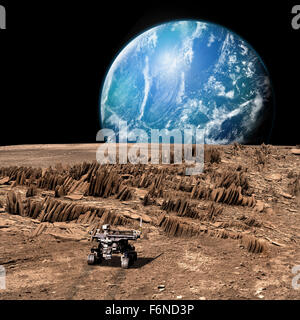 A rover explores a rocky, barren moon as a large, water covered world rises above the horizon. - Stock Image