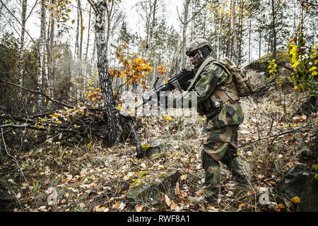 Norwegian Rapid reaction special forces FSK soldier patrolling in the forest. - Stock Image