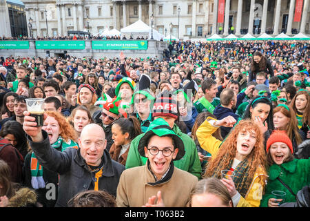 London, UK. 17th Mar, 2019.  Revellers in the Square. Following the spectacular St Patrick's Day Parade earlier, people celebrate and watch performances on Trafalgar Square in the heart of London. Credit: Imageplotter/Alamy Live News - Stock Image
