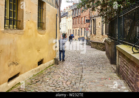 Tourist taking ipad photo in the old streets of Rennes the capital of Brittany, France - Stock Image