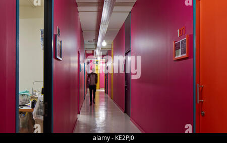 View along brightly colored hallway with studios. Pioneer Place, Durban, South Africa. Architect: designworkshop - Stock Image