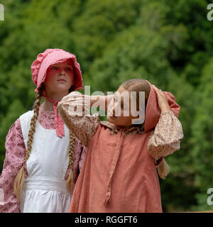 Duncan Mills, CA - July 14, 2018: Two girls at a civil war re-enactement. The Civil War Days is one of the largest reenactment events on the West Coas - Stock Image