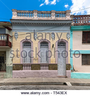 Facade of an old colonial house in the city. The image is a composite of three photos.  After economic changes, Cubans with possibilities are rushing  - Stock Image