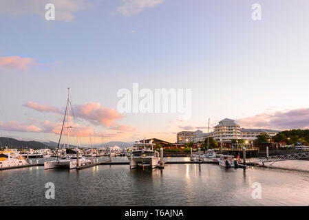 Atmospheric view of Cairns Marina at sunset, Trinity Inlet, Far North Queensland, FNQ, QLD, Australia - Stock Image