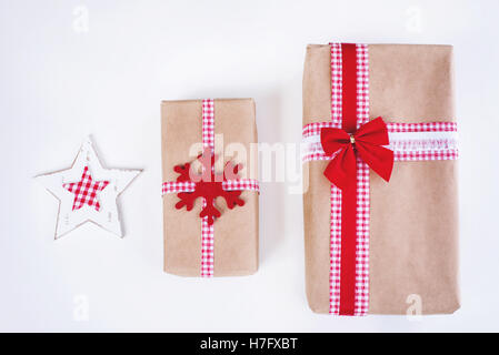 Wrapped vintage gift boxes with red ribbon bow - Stock Image