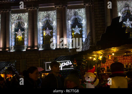 30 November 2018 The Belfast City Hall in Northern Ireland decorated with Christmas Lights and decorations with visitors to the annual Christmas Fair  - Stock Image