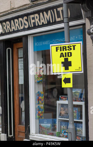 Bright yellow temporary first aid signs - Stock Image