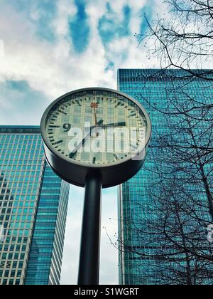Clock in Canary Wharf in London - Stock Image