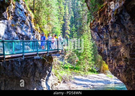 BANFF, CANADA - JUL 30, 2018: Visitors sightseeing at Johnston Canyon of Banff National Park, a popular hiking trail through the walkway on the limest - Stock Image