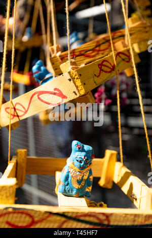 Vertical close up of a trinket tied to a wish-yielding tree at Kapaleeshwarar Temple in Chennai, India. - Stock Image