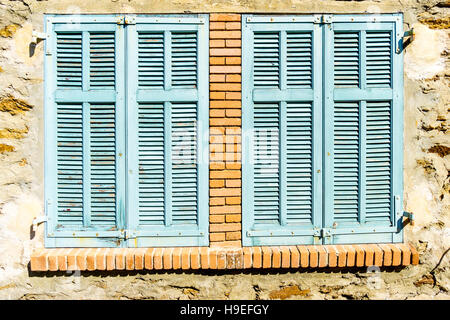 Mediterranean window with turquoise blue shutters in the South of France hilltop village of Gassin, Var, France - Stock Image