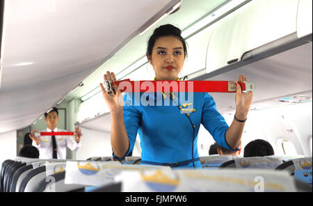 Yadanarpon Airline safety brief Myanmar Air steward explains the safety procedures to passengers on a commercial - Stock Image
