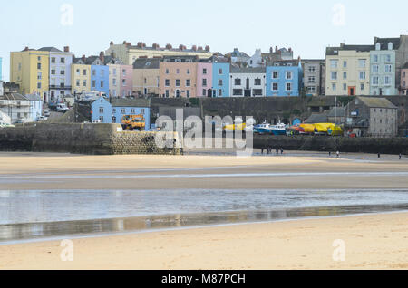 The colourful houses of Tenby, as seen from Tenby Beach, Pembrokeshire, South Wales - Stock Image