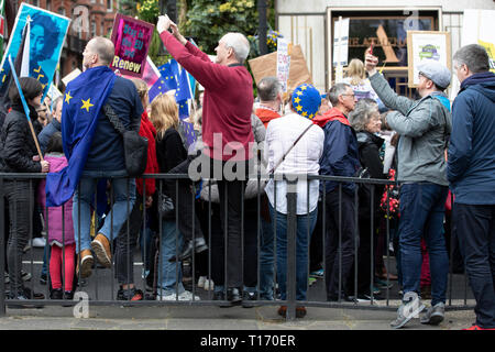 People watching and photographing People's Vote March, London, England - Stock Image