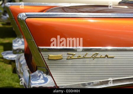 Floral Park, New York, U.S. 27th April, 2014. An orange 1957 Chevrolet Bel Air, with a ribbed aluminum inset in its tail fin, is exhibited by members of the New York Antique Auto Club at the 35th Annual Antique Auto Show at Queens Farm. Credit:  Ann E Parry/Alamy Live News - Stock Image