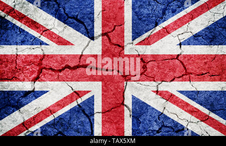 United Kingdom of Great Britain and Northern Ireland flag on dry earth ground texture background - Stock Image