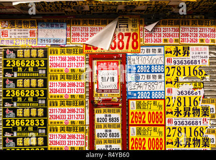 Street posters advertising apartments to rent in Hong Kong. - Stock Image