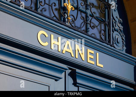 PARIS, FRANCE - JULY 21, 2017: Chanel luxury store sign on blue door in place Vendome in Paris, France. - Stock Image