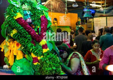 Hindu God Hanuman Decorated with Garlands and Offerings, Sree Veera Hanuman Temple, Kuala Lumpur, Malaysia. - Stock Image
