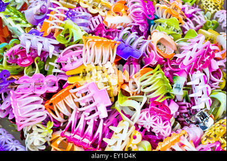 Colorful plastic hair clips as a background - Stock Image