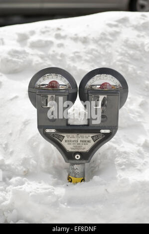 Lexington, MA, USA, 28 Jan, 2015. Parking meters buried in Snow in Lexington, MA.  Lexington is five miles North - Stock Image
