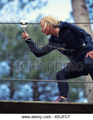 woman on zip wire - Stock Image