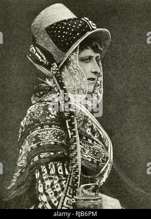 Milkmaid in special costume and bonnet, Belgium -- she apparently won a beauty competition for milkmaids. - Stock Image