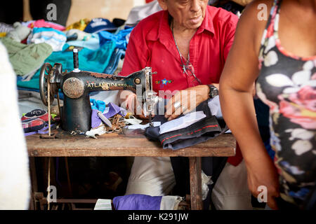 A street tailor with an old sewing machine in Belem Market, in Iquitos, Peru. - Stock Image