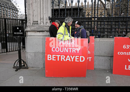Brexit posters supporters to leave the EU 'Your Country Betrayed' at Houses of Parliament in Westminster, London England UK 4 April 2019  KATHY DEWITT - Stock Image