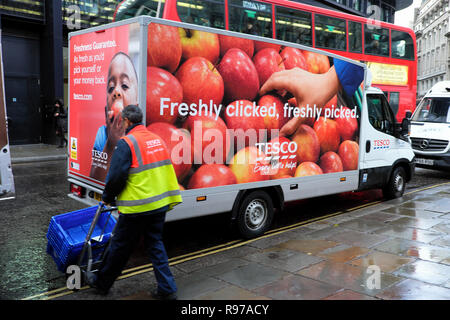 Tesco food delivery van with apples online advert on side parked in Threadneedle Street in The City of London UK  KATHY DEWITT - Stock Image